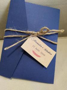 faire-part mariage bleu et kraft entre plume et perle